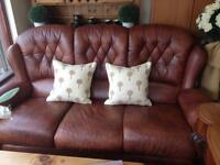 Brown leather three and two seater sofa set.