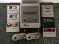 nintendo snes console with games not sega playstation or xbox