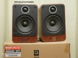 Q Acoustics 2020i Bookshelf Speakers in Walnut Finish.