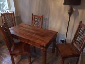 Varnished table and 4 chairs for sale