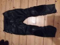 TRIUMPH LEATHER TROUSERS 32W AS NEW