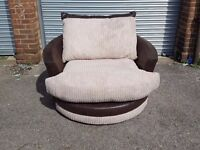Beautiful BRAND NEW Very large swivel cuddle chair.127cm. brown and cream cord. can deliver