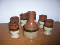 A STUDIO POTTERY CARAFE AND SIX GOBLETS.