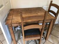 Small wooden kitchen table and 2 chairs