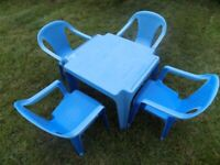 Toddlers outdoor table with 4 matching chairs.