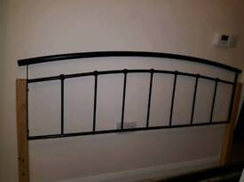 Black and wood double bed frame.