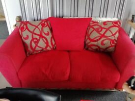 Red material three seater sofa