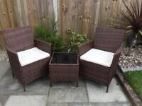 Garden Outdoor Rattan style two chairs and glass topped square coffee table. Now sold...