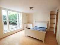 A bright & modern 2 double bedroom flat with a large conservatory & private garden in Kentish Town