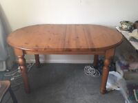 Extending pine table and 6 solid pine chairs