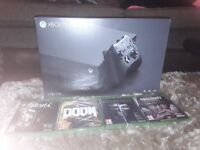 Xbox one x New sealed with 4 New sealed games