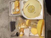 Medela Swing Single Electric Breastpump & spare Valve replacements