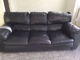 Black three seater sette plus two arm chairs