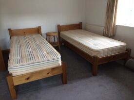 2 small single wooden beds