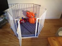 Lindam Playpen safe and secure with white rails and blue base