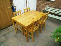 £45 solid pine dining table and four chairs