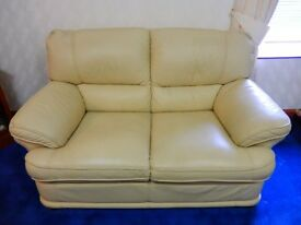 Cream Leather 2 seater sofa and matching reclining armchair