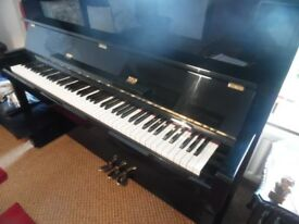 upright piano by kawai top of the range model HA 20