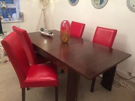 Dining room extending mahogany table and 4 x red chairs