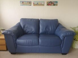 Pair of leather sofas. 3 seater and 2 seater in blue/ lilac