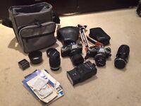 Two Olympus OM10 35mm SLR cameras + lens+ extras