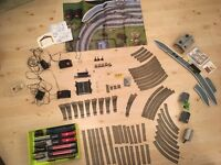 Assorted Hornby locomotives, trucks, track and buildings