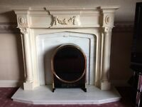 Fireplace surround with marble backplate and electric fire