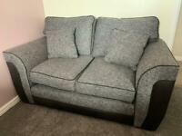 Grey Cord 2 seater Sofa trimmed in black/dark grey leather.