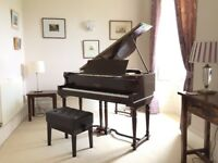 Eavestaff Baby Grand Piano and adjustable piano stool