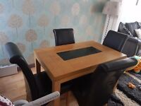 Dining table and chairs excellent condition