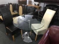Glass dinning Table and 2 leather chairs