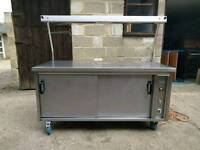 Stainless steel serving table with heated gantry