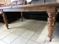 Lovely antique. Large solid wood dining table.