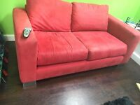 Red 2 seater sofa. Suedette
