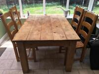 Solid (oak?) wood table and chairs