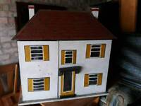 1970s dolls house with lots of furniture