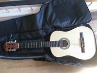 3/4 size classical acoustic guitar plus case plus spare silver plated strings