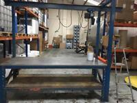Steel frame heavy duty bench with crane on rail.