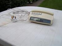 Audioline bedside telephone, radio, clock, alarm function.