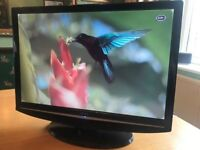A BUSH LT19M1CWA FLAT PANEL LCD WIDESCREEN TV TELEVISION WITH BUILT IN FREEVIEW AND HDMI