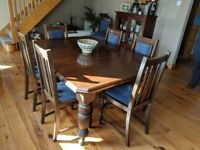 Antique Mahogany Dining Table with 8 solid wood chairs.