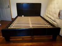 Brown faux leather bed