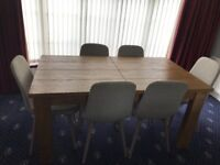 Next solid oak dining table and 6 Kenton chairs