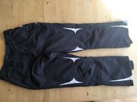 Parallel Ski pants in grey with white trim. Size 14