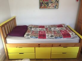 Single bed with mattress and storage drawers