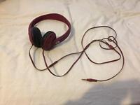 Maroon skull candy headphones