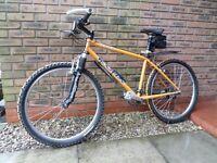 Kona 1998 mustard lightweight mountain bike.