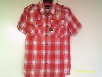 Terrific G Star Raw shirt. Size medium. Good condition. Metal stud fasteners.Really nice item.