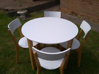 White round table and 4 chairs for use in kitchen or dining room