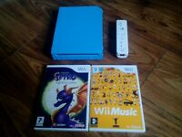 Blue Nintendo wii console with 2 games and remote